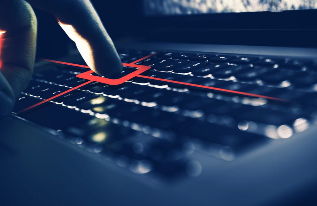 Finger on a laptop keyboard looking at keystroke logs as part of a computer forensics investigation service