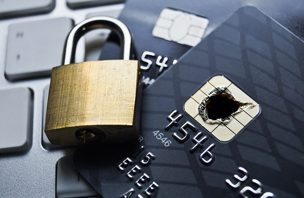 Theft investigation underway looking into credit cards and financial data to solve a private burglary investigation with security consultants in UK